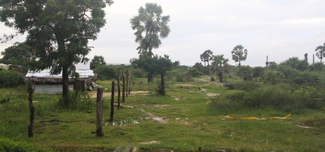 Peoples houses surrounded by minefields.
